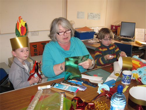 Museum volunteer Jan Cook ran a crown making workshop